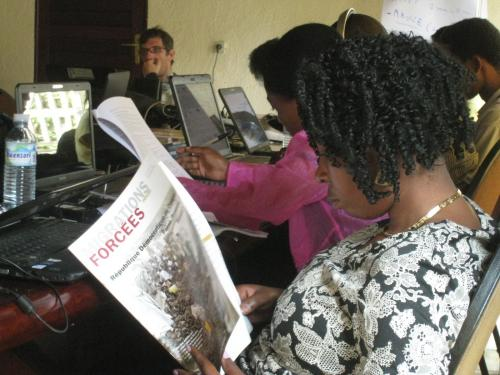 journalists%20reading%20FMR%20in%20Goma_0.JPG